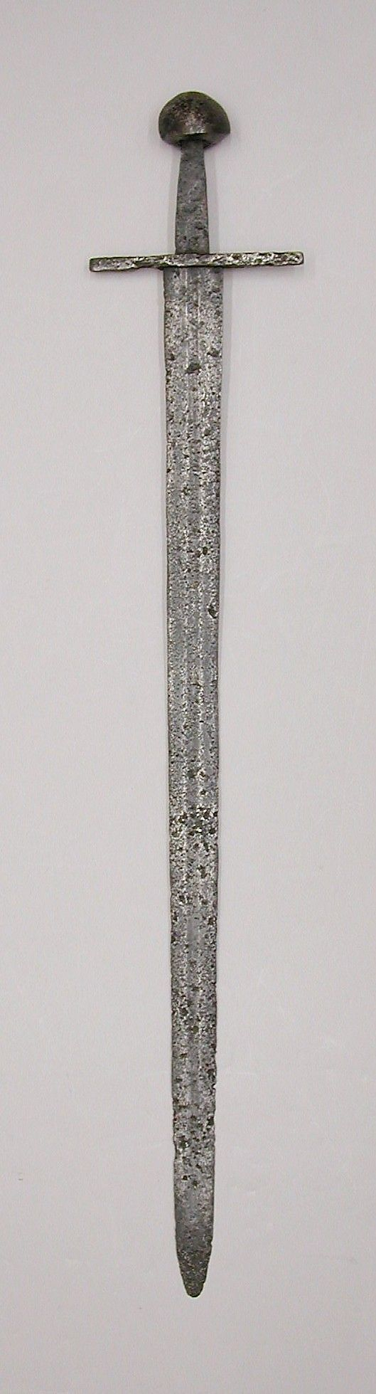 Sword, Date: possibly 12th–early 13th century Culture: Western European Medium: Iron Dimensions: L. 37 3/4 inches (95.9 cm); W. 6 3/4 inches (17.1 cm); Wt. 2 lb. 9 oz. (1158 g)  Metropolitan Museum of Art  Accession Number: 07.53.2