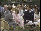 Prince of Wales biography row LIB Berkshire Windsor  Prince Charles sitting next Diana at polo match