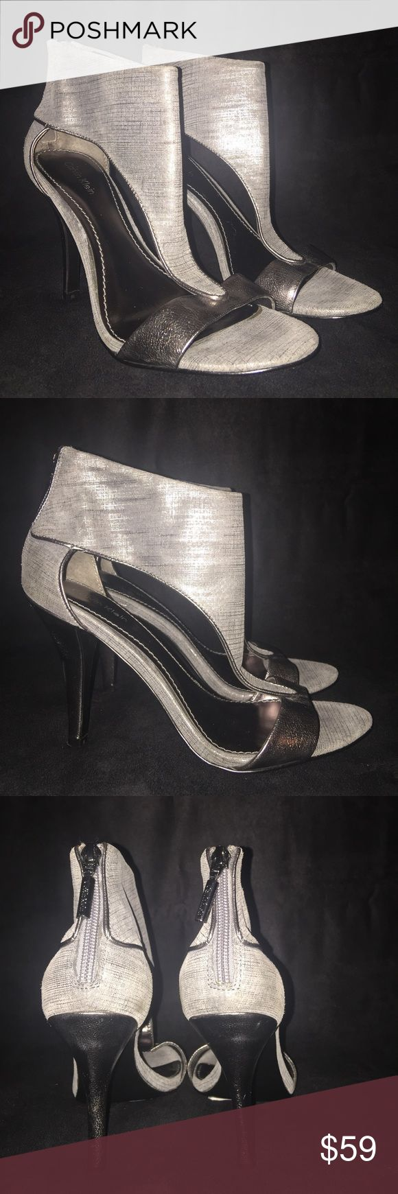 "CALVIN KLEIN T-Strap Pewter Sandal (9) NEW CALVIN KLEIN T-Strap Pewter Sandal (9) NEW NO Box (Retail: $119)  *4"" heel *Back zip closure *Pewter metallic covered heel, toe strap and trim Calvin Klein Shoes Heels"