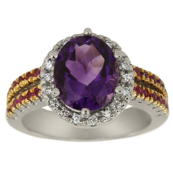 """Classic Diamond and Sapphire Accented Oval Amethyst Ring -  This ring is set with a 3.25ct center amethyst and 0.60ct of round accent sapphires and diamonds.    A February gemstone, this oval amethyst is an example of the phrase """"to the purple born!"""" This gorgeous purple amethyst is accompanied by brilliant white diamonds and pink sapphires set on the split shank. The powerful combination of deep purple, pink and white has a strong aura, and promotes sincerity and openness, and is..."""