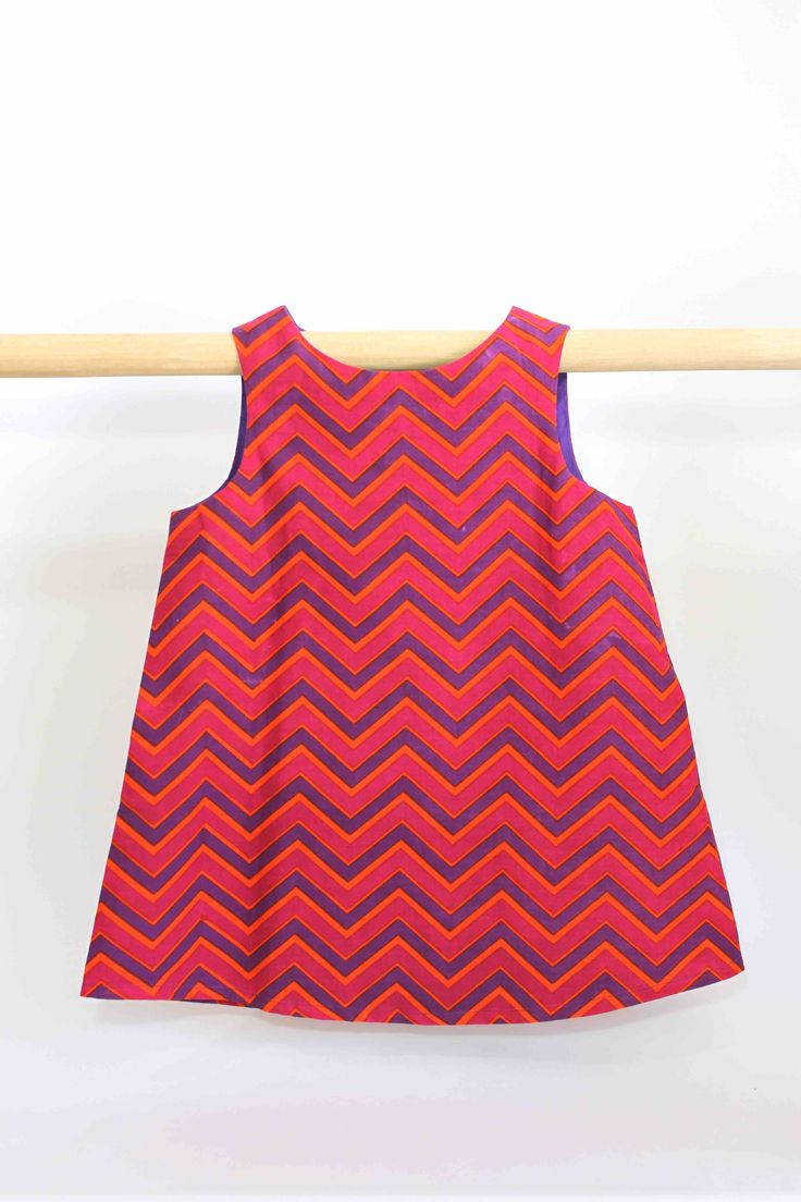 Retro Zigzag Reversible Dress: This super cute reversible summer dress can not only be worn two ways but is also comfortable to wear and easy to clean, making it perfect for all occasions and still allowing a kid to be a kid. Two dresses for the price of one.