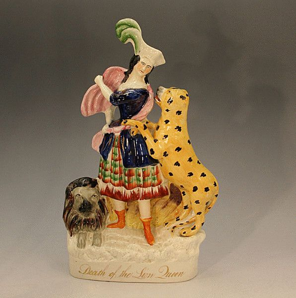Antique figure titled Death of the Lion Queen Staffordshire pottery