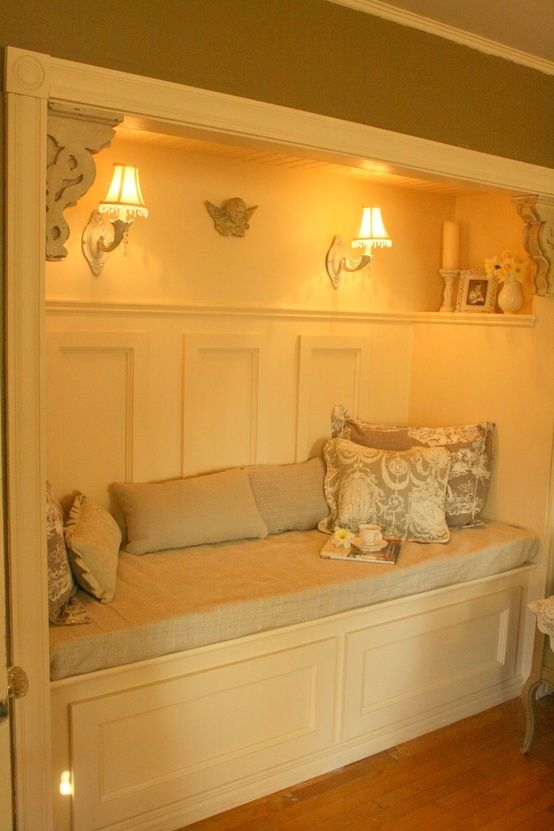 Closet turned reading nook-- I would spend hours in here. Perfect for a spare bedroom turned study.
