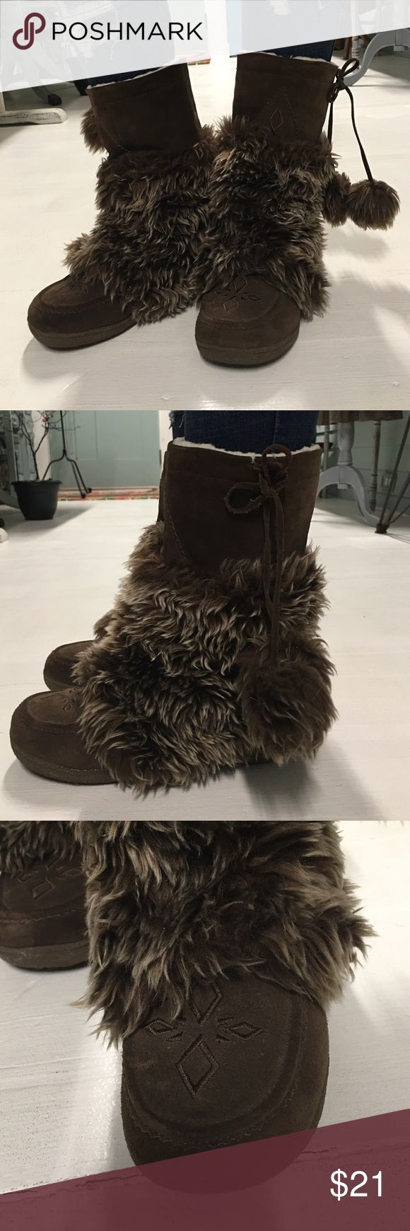 Eskimo boots , super cute size 9 Super cute something else by sketchers boots, full full with tie side and fur tassels , size 9 and worn only a few times , in great condition , color is brown , very warm Skechers Shoes Winter & Rain Boots
