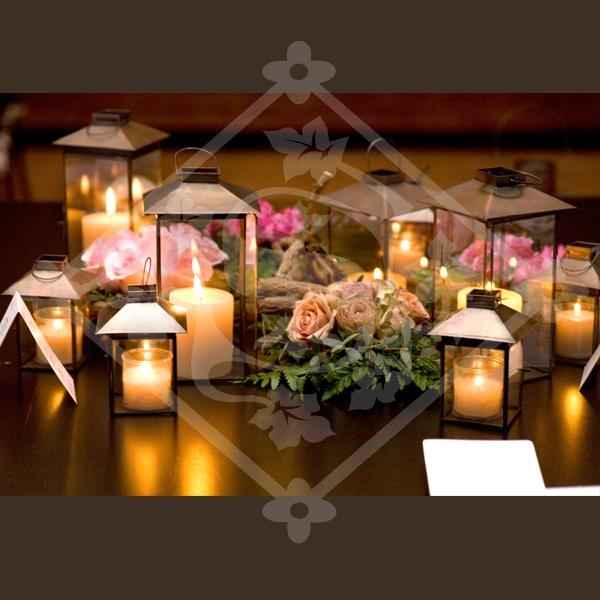 Faroles con velas para centro de mesa centros de mesa - Centros para decorar mesas ...