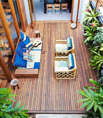The courtyard was decked in recycled timber, of course. The large wooden beams used as posts were from a bridge in Coffs Harbour, designed by renowned civil engineer Percy Allan. ECO TIP Sew together fabric remnants to make gorgeous patchwork cushions.