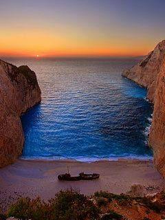 Navagio beach at sunset ~ Zakynthos island, Greece http://www.exquisitecoasts.com/best-beaches-in-greece.html