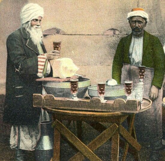 ŞERBETÇÍ (sherbet seller).  Istanbul (?), late 19th century.  'Şerbet' is a popular West and South Asian drink that is prepared from fruits or flower petals. It is sweet and served chilled. It can be served in concentrate form and eaten with a spoon or diluted with water to create the drink.