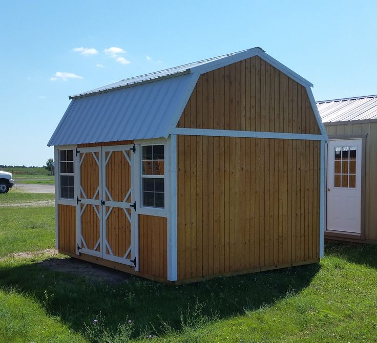 Grandview Buildings 10x12 Side Lofted Barn.  Polar White metal roof with matching trim.  Douglas fir siding stained Honeygold.  Ridgevent.  Minnesota Made.  Minnesota Owned.  Minnesota Nice.  We offer easy financing!