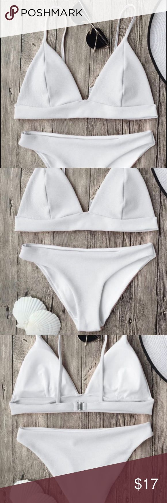White triangle bikini Brand new, never worn, white bikini with lining and removable pads. Purchased this item on June 5, 2017, so it is BRAND NEW and has never been worn! It is a size medium- I am 5'3 and 112 and it fit just a little too loosely. Swim Bikinis