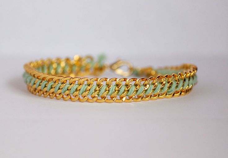 Woven Chain Bracelet You'll need:  - Finding  - Gold Chain  - Jump Rings  - Embroidery thread  - Pliers  - Wire Cutter