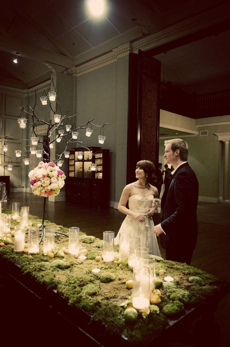 Moss and candle covered table. Photo by Traina Photography. #wedding #green
