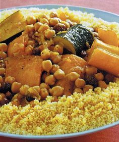 """a. replace sausage with merguez, browned. b. add 3/4"""" thick sticks of 1 small zucchini, 1 small yellow squash, 1/4 cup golden raisins, 1-2 julienned hot chilies after 10 min of cooking. c. Add large 2 cloves smashed peeled garlic with chickpeas. d. Serve with harissa."""