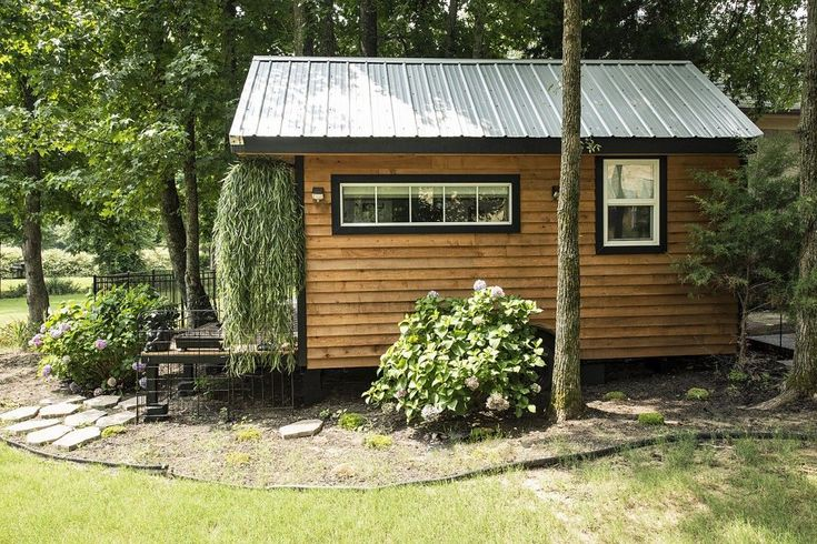 Mendy's Tiny Home 8x16 $25,000 - This model shown is 8x16ft. Model comes standard with: Queen size loft, kitchen sink, two burner portable stove, 3 cu. ft. refrigerator, IR heater, composting toilet, shower, on demand tankless hot water heater, 4 foot porch, and storage shed. Upgrades in the model shown are built in futon/couch, heated floors, granite counter tops, propane stove, and larger refrigerator. All other appliances, shelving, and decor are customer additions.