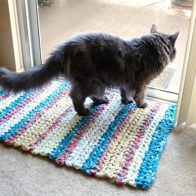 Crochet rag rug rectangle. The finished rag rug is a pretty accent for high-traffic areas in your home.