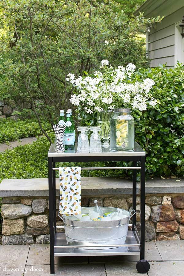 A simple outdoor bar cart for entertaining including beverage dispenser and galvanized bucket to chill drinks. And that cute pineapple towel is a HomeGoods find! (sponsored pin)