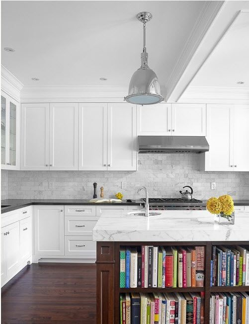 marble island + backsplash with black countertop