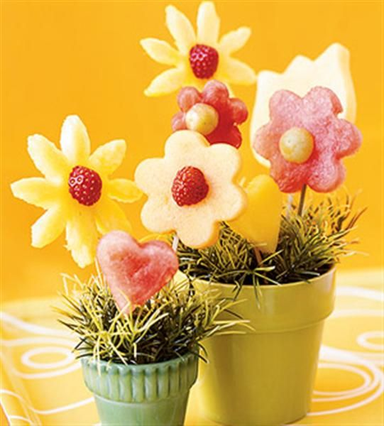 Mothers Day gift idea.  Use cookie cutters to cut watermelon and pineapple for a sweet edible bouquet. :)