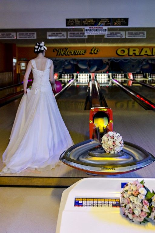Candid Photos of a Lifetime - What a very unique thing to do...  go tenpin bowling on your wedding day :)  Orange Tenpin Bowling www.candidphotosofalifetime.com.au