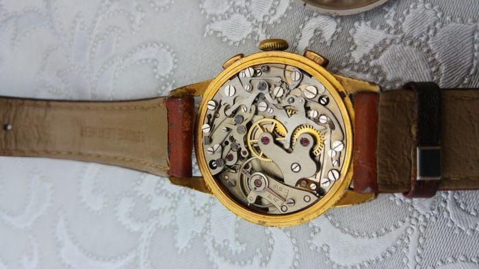 Hugex heren horloge periode: 1940-1950 (ongeveer).  Vintage chronograaf horloge uit de jaren 1940 - 1950.Diameter: 34.5 mm (ca.).Kwalitatief hoogwaardige Valjoux 77 beweging.Prachtige wijzerplaat met verschillende schalen.Het houdt de tijd goed en chronograaf functies werken perfect.Vergulde drukknoppen en kroon (wat chips).Originele blauwe handen.Ongerepte originele wijzerplaat.Met het meten van lederen riem: 22 cm in lengte.Het horloge wordt geleverd via aangetekende brief (met extra…
