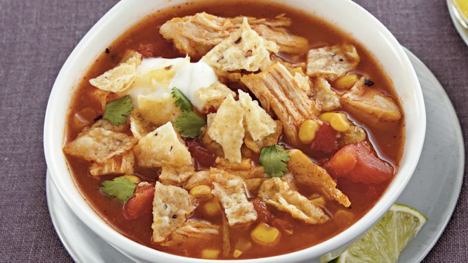 Progresso® broth, Muir Glen® tomatoes, corn, Old El Paso® enchilada sauce and chiles come together in this chicken soup – a perfect slow cooked  dinner.