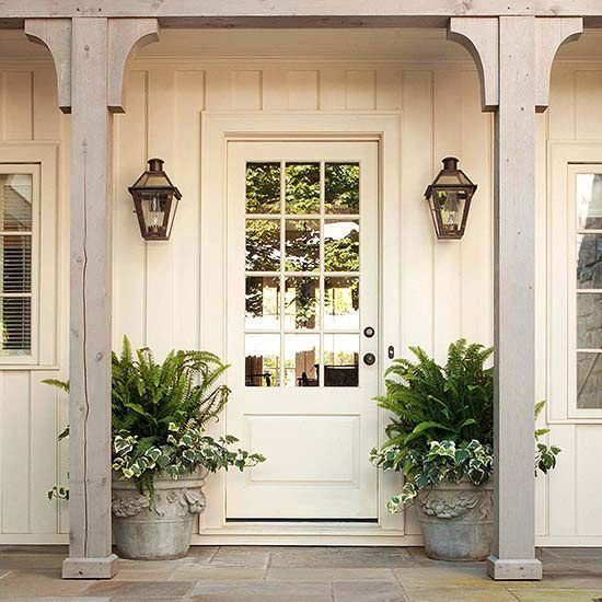 BHG-Front Door Symmetry With Big Potted Plants and Lanterns
