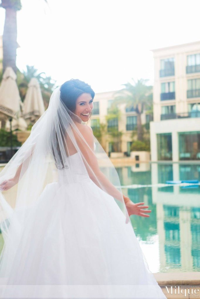 Gorgeous veil shot of the bride, amazing wedding photography by Milque Photography. Love the colours in these photos taken at the Palazzo Versace.