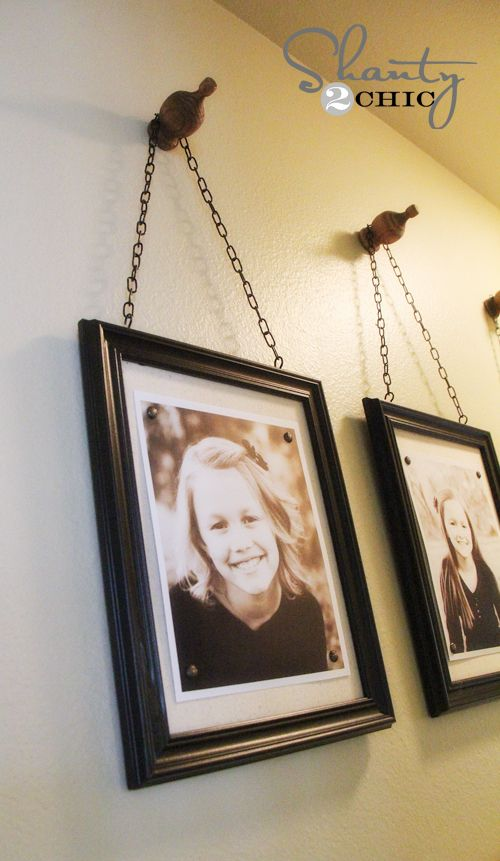 picture frames hanging on finials (diy)