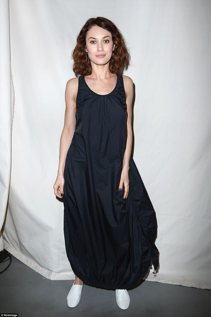 Bare-faced beauty: Olga Kurylenko looked pretty in a black waterproof dress and white pump...