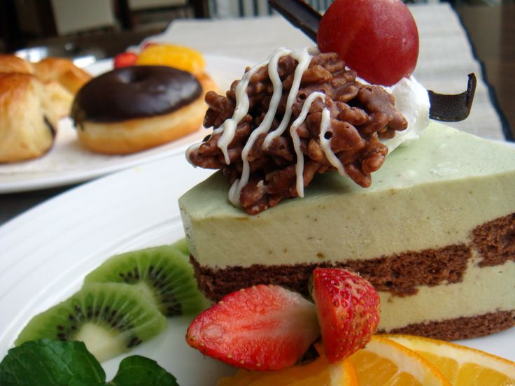 A slice of Cake of the day with best toppings. The tastes? Absolutely Delicious !!