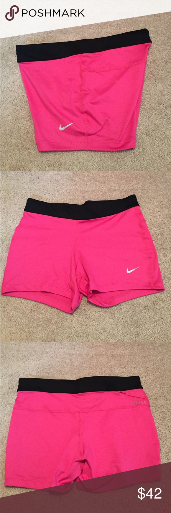 """NWOT women's Nike size medium spandex New without tags women's Nike running size medium dri-fit spandex shorts. Shorts have a drawstring tie as well as a small zippered pocket on the back of the shorts. The waist band can be rolled down and a saying on the back is shown and says """"run fast live fearless"""" Nike Shorts"""