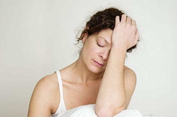Woman Experiencing Menopause Fatigue