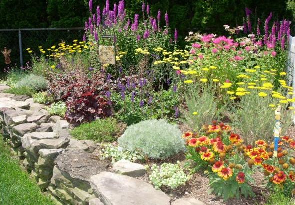 Hillside flower garden hillside gardens pinterest for Perennial flower garden designs