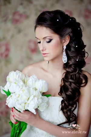 Lovely sideswept wedding hair with pearl adornments