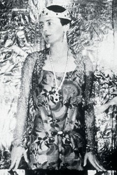 Lady Wimborne, photographed by Cecil Beaton, wearing a Chaumet ruby and diamond bandeau tiara, with matching earrings and sautoir in the Art Deco style.
