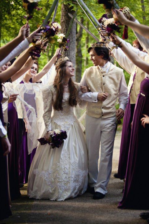 Swords raised by wedding party for bride and groom to walk under.   Could do the same with ribbon wands, if shared with guests