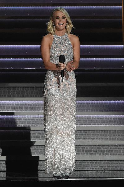Carrie Underwood Photos Photos - Carrie Underwood performs during a tribute to Dolly Parton at the The 50th Annual CMA Awards at Bridgestone Arena on November 2, 2016 in Nashville, Tennessee. - The 50th Annual CMA Awards - Carrie Underwood Fashion