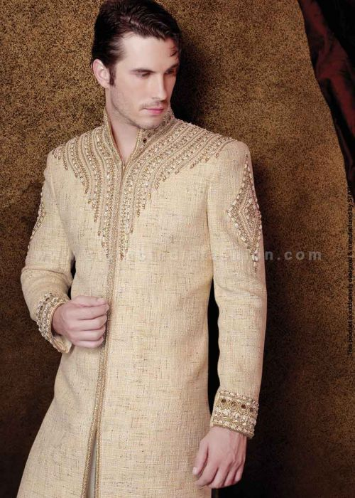 <p>This majestic cream color indo western suit in jute fabric is designed with french work with nottched stitching high neck ,jardoshi ,along with matching bottom</p> <p><strong><br /></strong></p> <p><strong>Kindly contact us at info@statusindiafashion.com to buy this product in similar fabric</strong></p>