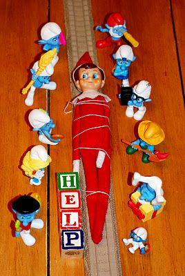 """Elf on the Shelf all tied up by the """"Little Toy People""""...."""