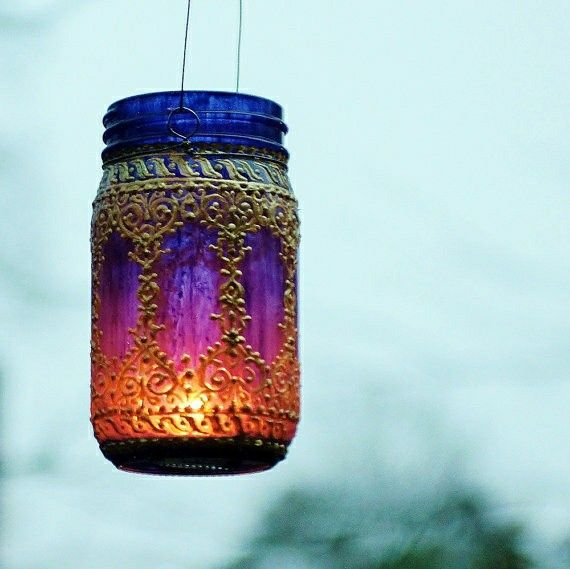 stained mason jar with candle placed in it