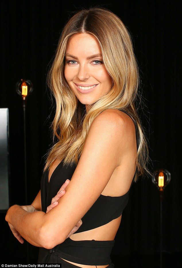 Bronzed beauty: The entrepreneur was sun-kissed all over her body - most likely a result of tanning with her Jbronze by Jennifer Hawkins self-tanning range