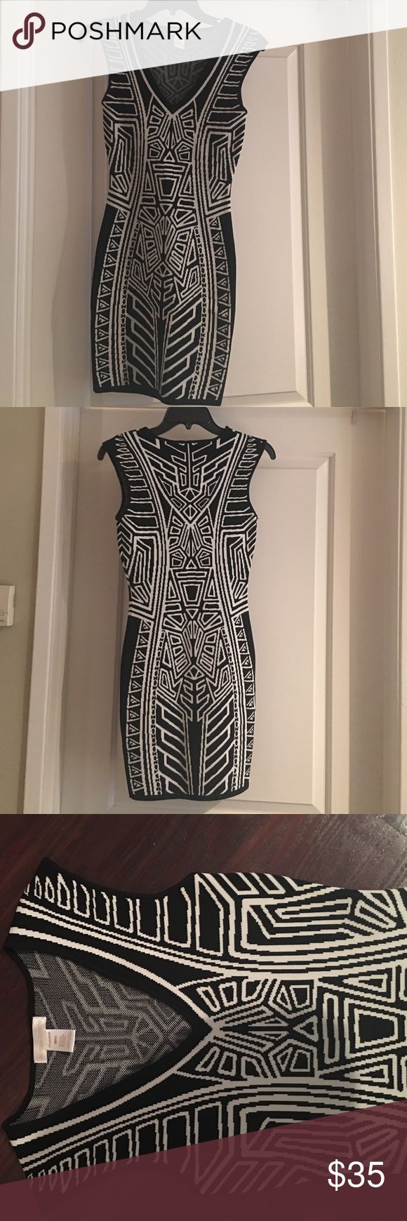 NWOT black and white bodycon dress! NWOT black and white bodycon dress! Amazing fit and stretchy material hugs you in the right ways! Dresses Mini