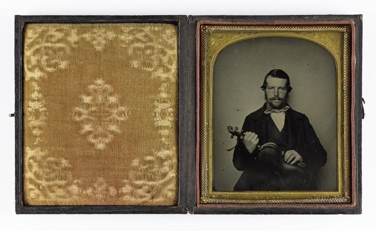 1/8 plate ambrotype, depicting a seated man holding a violin, unsigned, 1850s