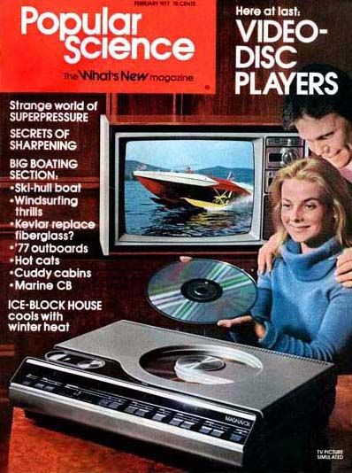 "February 1977 – Popular Science   ""Here at Last – Video-Disc Players""    This is the very first major magazine article ever written about Laserdisc Players… The Magnavox 8000… Although a little premature, Laserdiscs were born…kind of? - www.remix-numerisation.fr - Numérisation - Capture - Transfert audio et vidéo - Restauration audio"