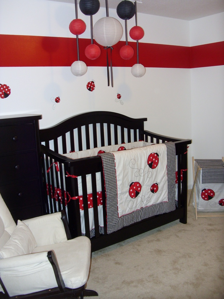 Ladybug Nursery-Paper lanterns hung from dowel rod from hooks on ceiling.  Used ribbon to connect.
