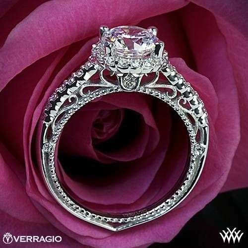 This Diamond Engagement Ring is from the Verragio Venetian Collection. It features 0.35ctw of Round Brilliant Diamond Melee (F/G VS) that enhance a round or cushion diamond center of your choice. The width of this ring is 2mm. Select your diamond from our extensive online diamond inventory. Please allow 4 weeks for completion. Platinum rings carry a 5 week turnaround time. If you have any questions regarding this item then please contact one of our friendly diamond and jewelry consultants at…