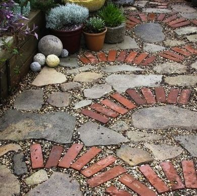 Recycled materials can be used to create one-of-a-kind driveway surfaces. Just take the example at left, where brick, stone, and gravel have come together to create a beautiful, sustainable solution