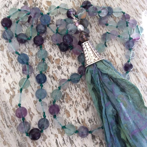 I love the colours of these fluorite gemstone beads, Ive hand knotted them to make this beautiful long necklace.  The sari silk tassel is made of