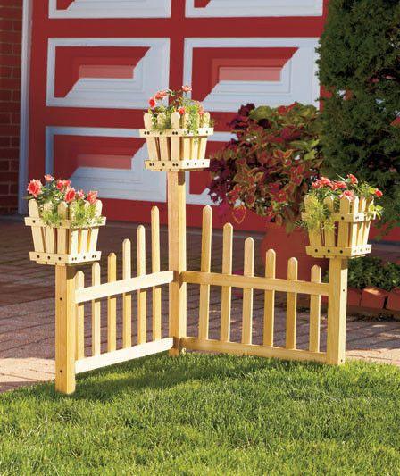 Wooden corner planter picket fence flowerbed landscape for Wooden flower bed ideas
