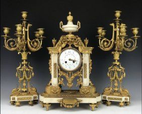 A MAGNIFICENT DORE BRONZE MOUNTED MARBLE CLOCK SET